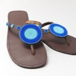 blue rounded beaded shoe with round disc